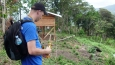 Tim Klug and other students take measurements around a house being built near the top of a watershed in Panama.