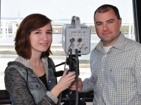 Jackie Ringhausen, left, a Master's degree student in atmospheric science from Hardin, MO., and UAH's Phillip Bitzer check the high speed video camera they use to record lightning flashes. (UAH photo. High resolution available on request.)