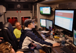 Inside the MIPS command vehicle, UAH's Kevin Knupp and Ashley Ravenscraft, a senior at UAH, monitor the storm passing overhead.