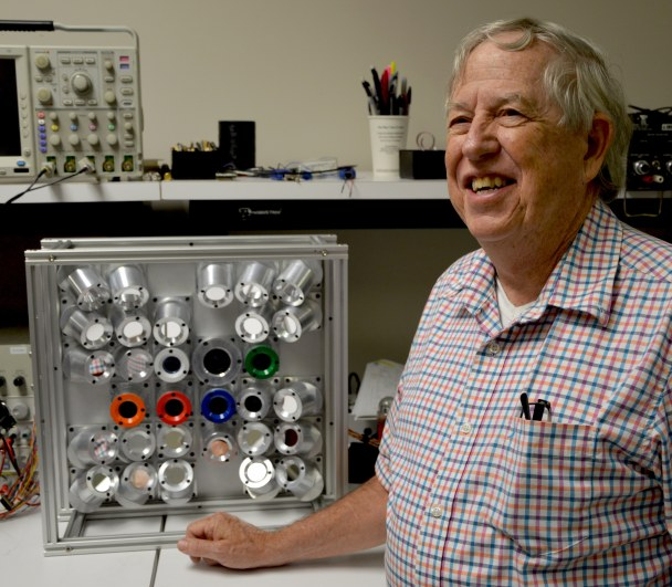 Dr. Hugh Christian, professor of atmospheric science at UAH, poses with the Fly's Eye GLM Simulator in an electronics lab in the National Space Science and Technology Center at UAH. (UAH photo by Phil Gentry)